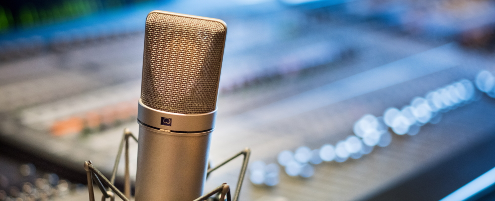 God's Superior Voice: studio microphone against blurred studio background