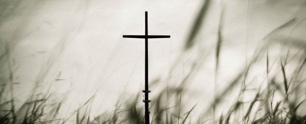 Your Identity in Christ: cross silhouette against light background